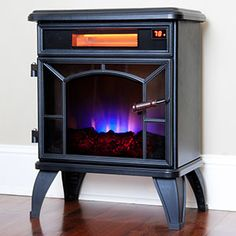The Duraflame Freestanding Infrared Electric Stove features an old world look with modern technology. Enjoy powerful infrared heat for up to 1000 Sq Ft. Electric Stove Fireplace, Free Standing Electric Fireplace, Fireplace Heater, Fireplace Wall, Electric Fireplaces, Southwest Home Decor, Infrared Heater, Animal Wall Decals, Dressing Area