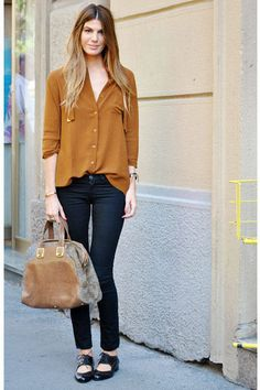 Bianca Brandolini d'Adda perfects a casual daytime look in a slouchy silk blouse and cropped black jeans.