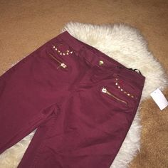 Burgundy Jeans With Studs & Zippers NWT. Studs and zipper embellishments. No trades or pp. Charlotte Russe Pants