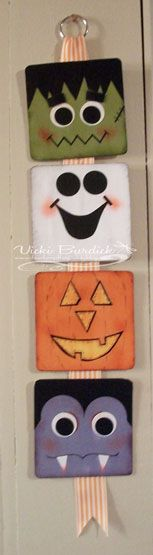 Halloween door hanger made with blank coasters. Supplies are paper, ink, 3/4 inch circle, 1-1/4 inch circle punches, sponges, star punch, top note die, mono adhesive, mod podge and ribbon.