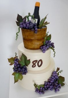 Wine Cake Iced In Buttercream Except For Top Tier Shaped And Covered