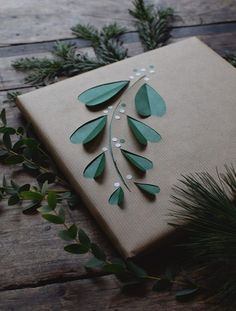 I love this DIY gift wrap idea with cut out mistletoe via the Swedish blog, At Home with Helena.