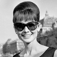 """Audrey Hepburn photographed by Roger Viollet during a press conference for the publicity of her new movie """"Paris When It Sizzles"""". Paris (France), June 16, 1962."""
