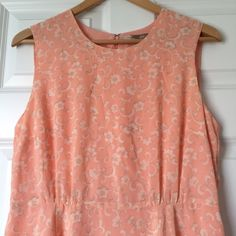 Forever 21 Contemporary Peach/Coral Floral Dress L NWOT Forever 21 Contemporary Dress in a peach/ coral color with a delicate and whimsical white, tan floral print. Beautiful for the spring and summer. Details include little pleats in front and back as well as a slit in the back which creates a flowy look. Bought with intentions of wearing and now does not fit. 19 Inches Underarm to Underarm, 40 Inches Shoulder to Hem, 16 Inch Waist, hips around 22 Inches (all measurements taken while flat)…