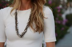 white top and statement necklace