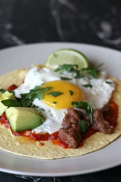 Huevos Rancheros : quick, easy, delicious & glutenfree! This one has directions for home made cherry tomato sauce.
