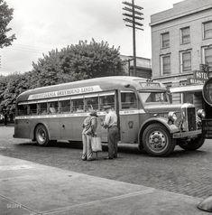 """September 1943. """"Washington Court House, Ohio. Passenger boarding Greyhound bus."""""""