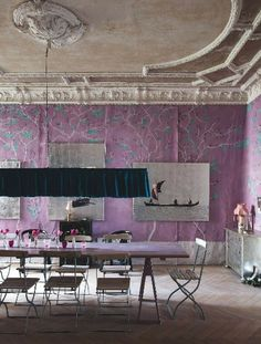 Dining room featuring purple wallpaper and turquoise light fixture... plaster ceiling