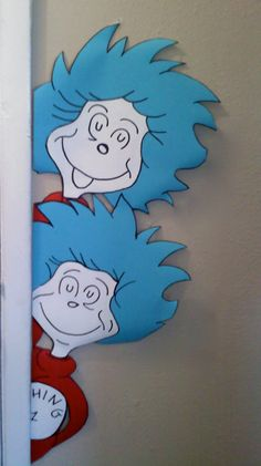 Dr. Seuss inpsired Thing 1 and Thing 2 door or window hugger from Cat in the Hat.  Wall decal.. $18.99, via Etsy.