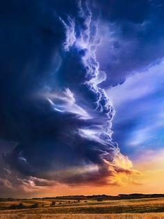 ~~Sunset on Arcus   Cumulonimbus Arcus cloud, Kansas   by Jeffrey McPheeters~~