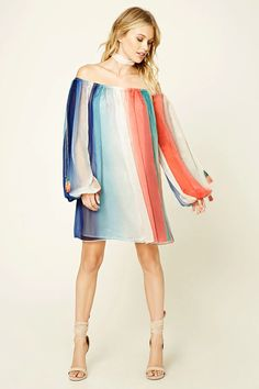 A woven dress featuring a multi-color design, open shoulders, self-tie cami straps with tasseled ends, and a boxy silhouette. This is an independent brand and not a Forever 21 branded item.