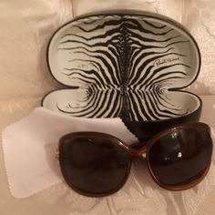Roberto Cavalli  Sunglasses Beautiful brown Roberto Cavalli sunglasses❤️ authentic❤️gently preowned❤️includes box and dust cloth❤️ The sides are encrusted with the RC logo and the serpent logo wrapping around in all rhinestones❤️all rhinestones are intact❤️zero defects,scratches or flaws❤️average wear reflects price❤️original was $250❤️tradesI give bundle discounts❤️please use offer button via all listings❤️Thank You Roberto Cavalli Accessories Sunglasses