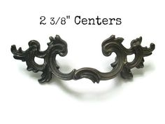 **PLEASE CHECK MEASUREMENTS CAREFULLY - This is a rare, small version of this pull** -1 vintage French provincial drawer pull with both screws -Great,