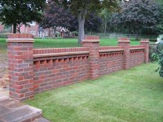 "9"" garden wall with 18"" piers and a Dog tooth feature, finished with a brick on edge and Creasing tile finish."