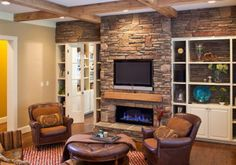 stone fireplace with tv above it  See how the fireplace is low and wide so TV can come down to better viewing angle