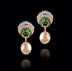 Farah Khan Ali diamonds, emerald, and pearl earrings.