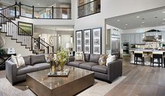 A dramatic two-story ceiling adds to the glamour of this elegant great room | Heidi plan by Richmond American