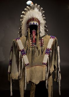 This War Shirt is pictured with the Victory headdress but the headdress is sold separately. The shirt is handcrafted and painted with the highest quality materials and the utmost care is used by artist Russ Kruse. Each detail is crafted into the leather with painstaking care. This is a piece that will be able to grace your collection for years of authentic beauty.