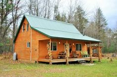 This is definitely NOT a tiny cabin but it's still an awesome solar off-grid log cabin on 20 acres for sale in Michigan. It has three rooms, one bathroom, and a large kitchen. The cabinis self suf...