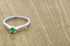 0.5ct Emerald & Diamond Ring