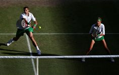 Max Mirnyi of Belarus plays a forehand next to his partner Victoria Azarenka of Belarus during their Mixed Doubles Tennis gold medal match against Laura Robson of Great Britain and Andy Murray of Great Britain on Day 9 of the London 2012 Olympic Games at the All England Lawn Tennis and Croquet Club on August 5, 2012 in London, England.