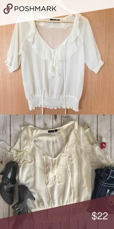 """a.n.a. cream flowy chiffon blouse with ruffles Beautiful, light, girly top that goes great with any color bottoms (I like a bright bold jegging, personally). Sheer, light material that is quintessential style for spring and summer! Gently used, but in excellent condition. Measurements laying flat: bust 20"""", length 24"""", arm 13"""" a.n.a Tops Blouses"""