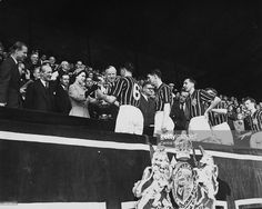 Queen Elizabeth II presents the FA Cup trophy to R Paul of Manchester City after his side's 3-1 victory over Birmingham City in the FA Cup final at Wembley Stadium.