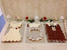 Bridal shower cupcake display that honors the bride, groom, and the engagement ring.  See more bridal shower cake ideas at www.one-stop-party-ideas.com