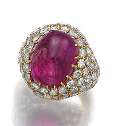 RUBY AND DIAMOND RING, MONTURE, BOUCHERON. Of bombé form, set to the centre with a cabochon ruby, surrounded with circular-cut diamonds, size 45, signed monture Boucheron, French assay and partial maker's mark.
