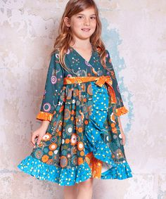 With a darling mix of prints and ruffle trim, this dress is ready for a walk on the smile side. A wrap front and soft cotton keep cuties comfy with delightful ease.