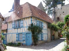 Gerberoy - a hint of Picardy and Normandy.  The houses are half-timbered or brick or flint.  Well kept village is a delight to walk through - narrow paved streets, old 17 and 18C houses, climbing roses, wisterias, and flowers.