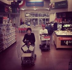 Just Oli Sykes casually driving a handicapped shopping cart through Walmart. No biggie.