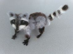 Check out this item in my Etsy shop https://www.etsy.com/listing/224647400/ooak-needle-felted-fiber-art-racoon-hand