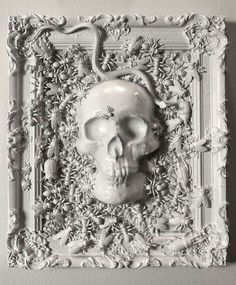 Stylish white skull frame. Ornate frame, skull, plastic creepy crawlies, all spray-painted white | White Halloween decor | Halloween frame | DIY skull picture
