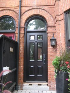 This Charming Urban Home Features A 6 Panel Amberwood Mahogany #door, With  4 Glass