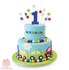 For Nicholas's first birthday we created this two tier car and cloud themed cake. Thomas Birthday Cakes, Birthday Cake Kids Boys, Baby Birthday Cakes, Baby Boy Cakes, Birthday Treats, Cakes For Boys, Happy Birthday, 1st Year Cake, Pink Cake Box