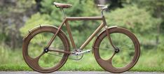 Awesome carved bike by Jan Gunneweg.  I've seen wooden frames before but the asymmetrical wheels are way cool.