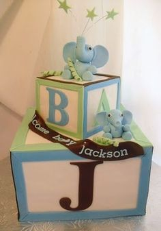 """Baby Blocks Cake! This cake was done for a client's """"mama elephant, baby elephant"""" themed baby shower. Bottom tier was a six layer chocolate fudge and french vanilla cake combo, and top tier was red velvet. Mama and baby elephant hand sculpted from sugar paste."""
