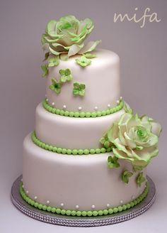 Green Wedding - White wedding cake with green roses, hydrangeas and pearls for green themed wedding