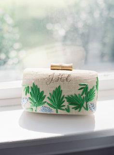 A Kayu clutch embroidered with my new initials. I loved that the blue and green leaves echoed the scenery of Shelter, and the beachy design made it perfect for our honeymoon in Greece. - Over the Moon