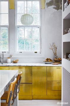 minimalist kitchen ideas // brass covered kitchen cabinets