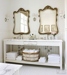 Mix a Shaker-inspired bath table with ornate gold-frame mirrors for a vintage-meets-modern look that feels more collected than designed. The brushed-nickel faucets, a marble countertop with a traditional edge detail, and a white finish keep it feeling fresh. A wicker basket and tiny drawer add quirk to the bathroom vanity design./
