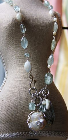 http://shelbilavender.com/necklaces-2/027-3/ Direct Link Aquamarine, Coral, Mother of pearl, sterling, vintage elements – love this mix