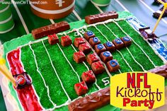 Football Field Cake Tutorial - perfect for your football party!  Easy and delicious! #Football #Food #recipe  #SnickersMinis #cake