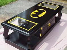 This <i>Batman</i> coffee table is perfect for a family game room.