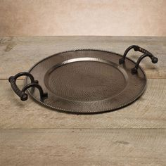These handled trays have the same iconic embellishments as the Antique Copper Servers – beading around the edges and a hammered style. Your choice of round or oval in a soft Antique Silver finish. Table bling for the holidays, $128.00