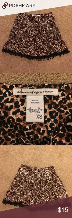 American Rag Skirt Fun cheetah print skirt! Black lace trim along bottom. Side zipper. Never worn and in great condition! American Rag Skirts Circle & Skater