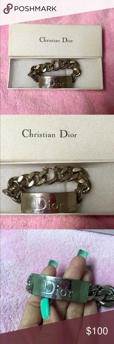 Authentic Christian Dior bracelet This is an authentic Christian Dior bracelet with the original box. I have had this for a while so as you can see in the picture the front does have scratches on it and it is a little worn but still a beautiful Dior piece. Christian Dior Jewelry Bracelets