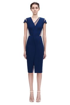 v neck insert fitted £1875.00  A fitted, cap sleeve dress in a navy compact crepe material with a sheer polka dot tulle insert, from the Pre Spring Summer 15 Ready-to-Wear Victoria Beckham collection