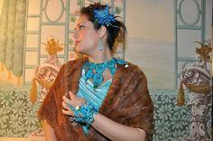 Authentic HUngarian coin folk jewellry redesign necklace, earrings, bracelet. Antique coins and blue, turqouise coloured grinded glass beads are sewed on a wool./ Rábaközi lázsiás, nyakék, fülbevaló, karkötő redesign. Csiszolt kék, türkiz színű üveg gyöngyök, antik pénzérmék vannak gyapjú anyagra varrva.